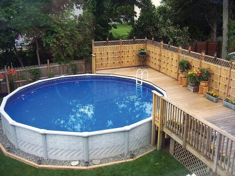 Small backyard landscaping ideas with above ground pool for Above ground pool decks diy