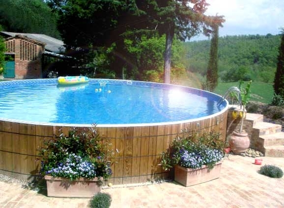 Small backyard landscaping ideas with above ground pool for Decor around swimming pool