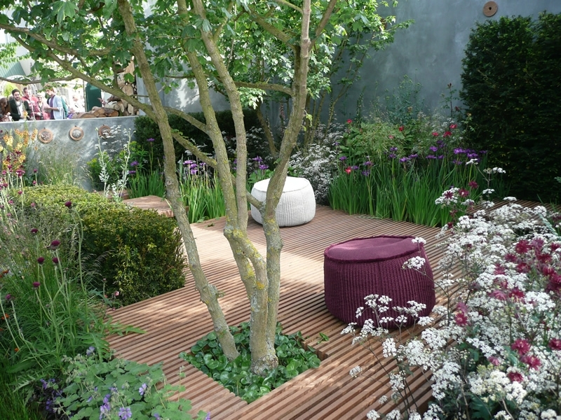 Small Concept Garden Has Slatted Decking And Very Loose Wildflower in Garden Designs For Very Small Gardens