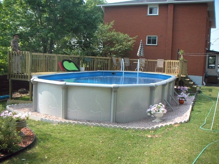 Small backyard landscaping ideas with above ground pool for Above ground pool designs
