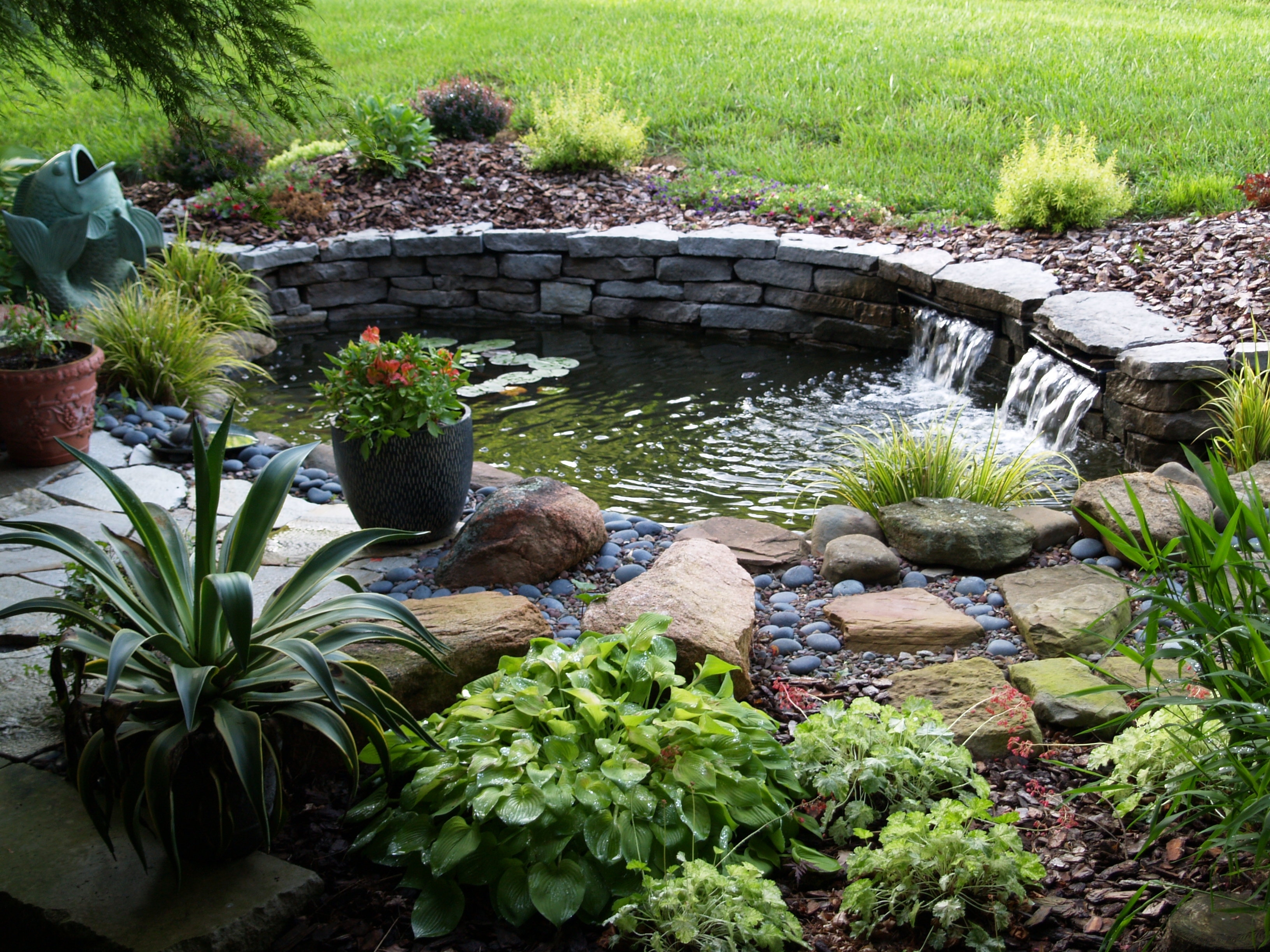 How To Build A Raised Pond In Your Garden - Clickhowto with regard to Backyard Garden With Pond