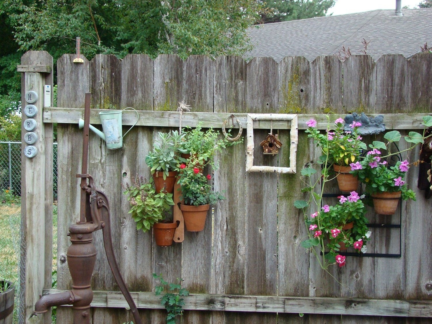 Old-And-Rustic-Backyard-Garden-Fence-Decoration-With-Vertical with regard to Rustic Backyard Garden Ideas