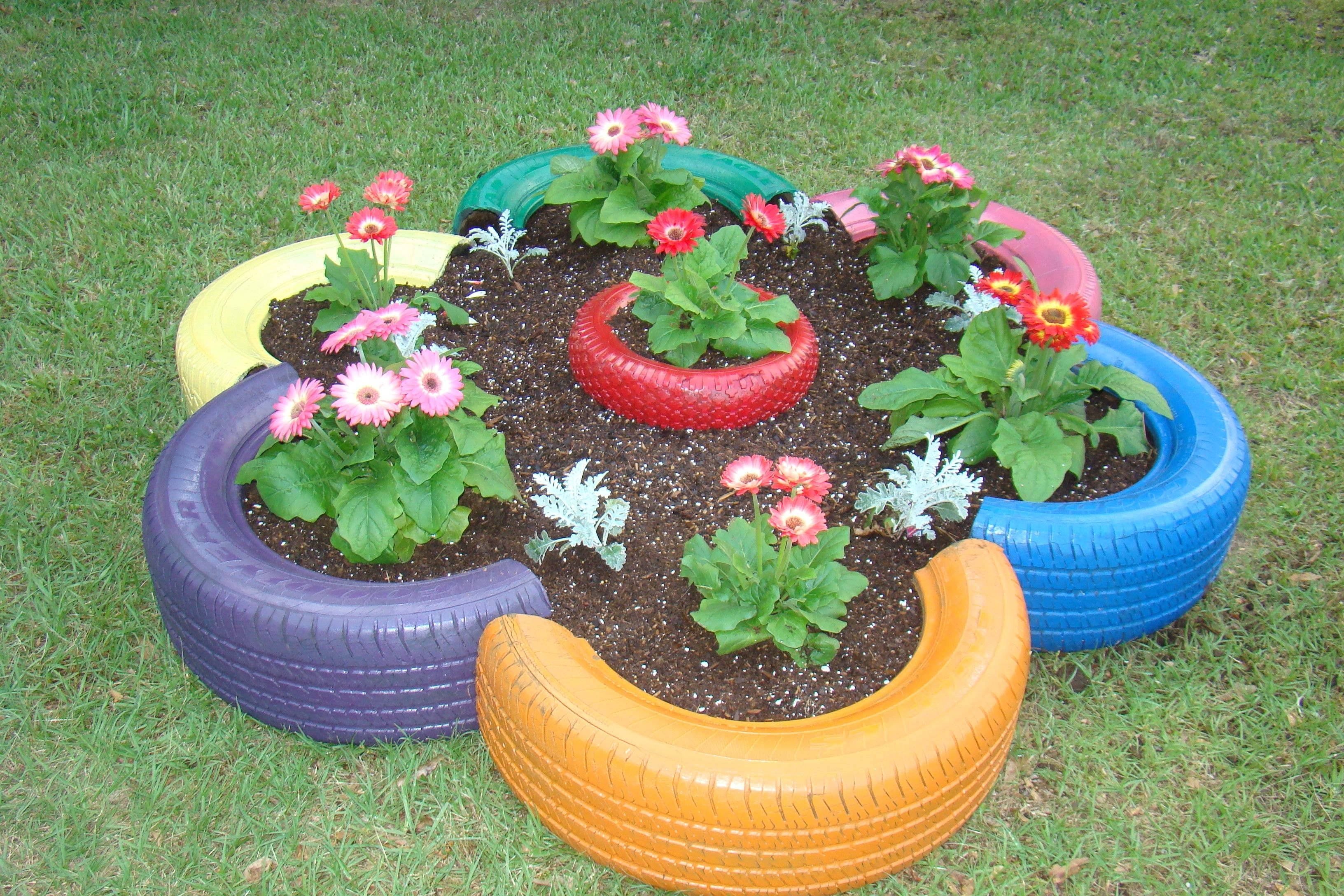 Flower Bed Made From Old Tires And Small Tire In The Center. | My within Flower Garden Using Old Tires