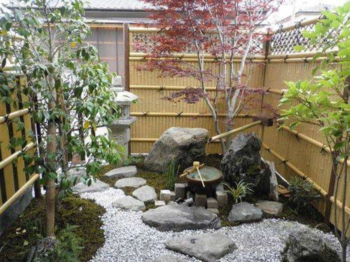 Small Japanese Gardens With Bamboo Fences And Fountain Tranquil Zen inside Zen Garden Ideas With Fountain